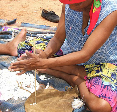 nharo making ostrich eggshell beads