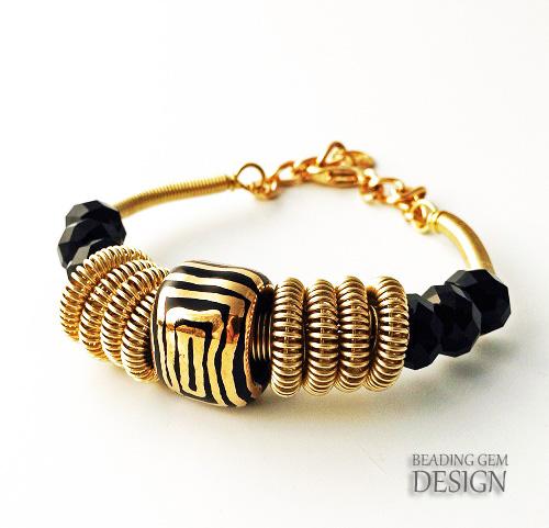 wire coil bracelet with Kazuri bead