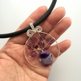 purple flower bead vase pendant in hand